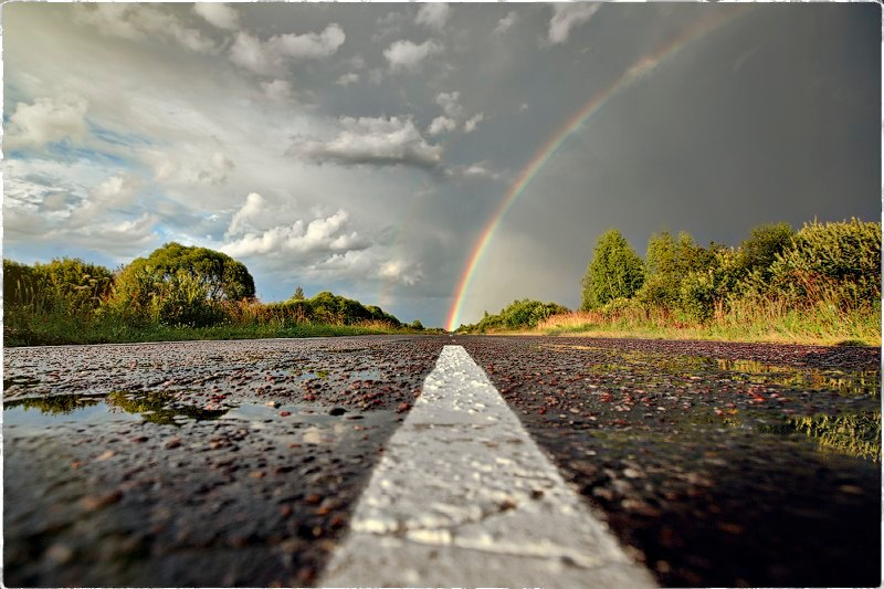 Rainbow on road | Photograph by Yuri