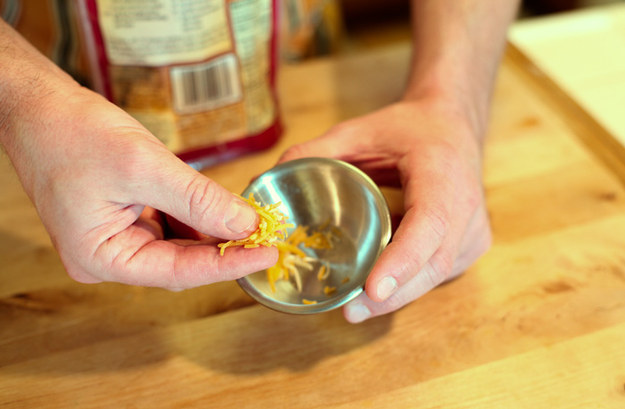 Take a pinch (about 1 teaspoon) of shredded cheese.
