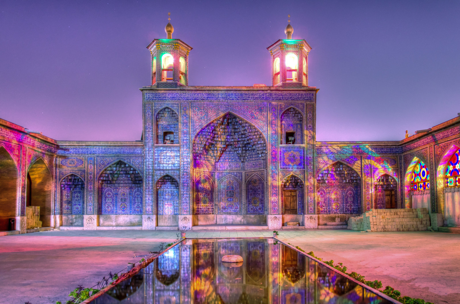 "The building, known as the ""Mosque of Colour"", is adorned with stained glass, patterned carpets, and bright ceiling tiles, creating a stunning effect when the sun shines through the windows."