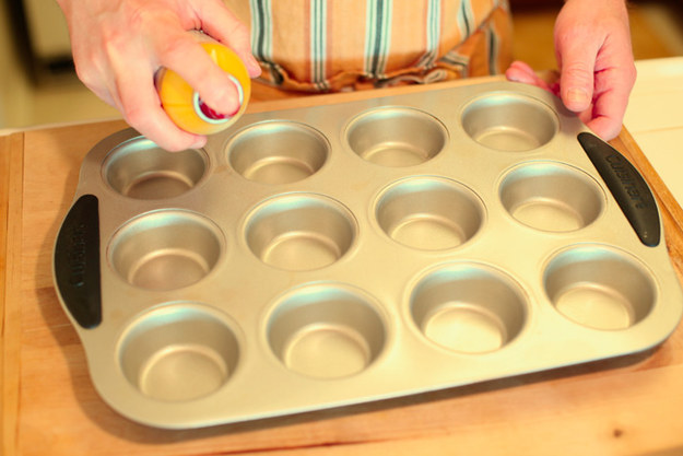 Using a muffin tin, apply cooking spray to prevent cake from sticking.
