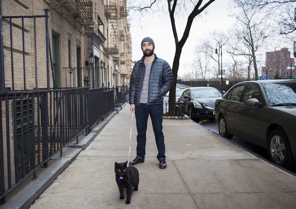 "Brooklyn resident David Williams has been making a photo series called ""Men & Cats"" featuring guys and their feline friends since 2009."