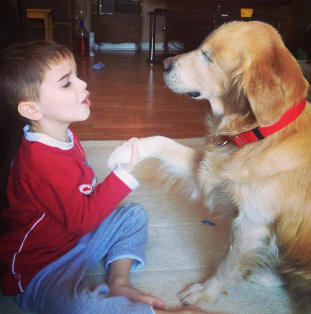 Here's Smiley, a 10-year-old Golden Retriever, with one of his many friends.