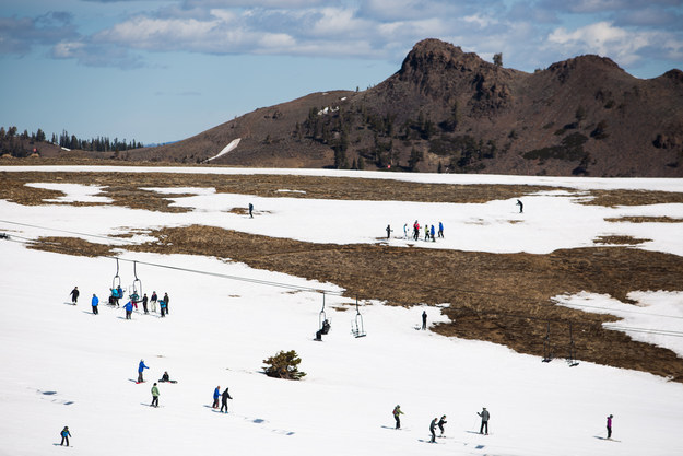 Photos from resorts show people attempting to ski and snowboard amid large patches of barren ground.