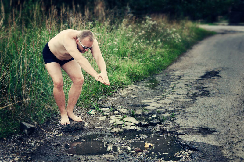 These People are Taking Funny Photos to Highlight their City's Pothole Problem