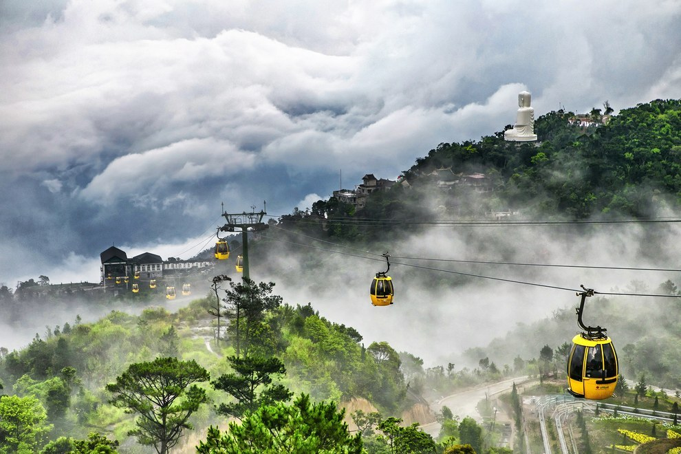 This astounding shot of the Ba Na Cable Car emerging from the fog in Vietnam displaying how the interaction of mankind and Mother Earth can be astonishing: