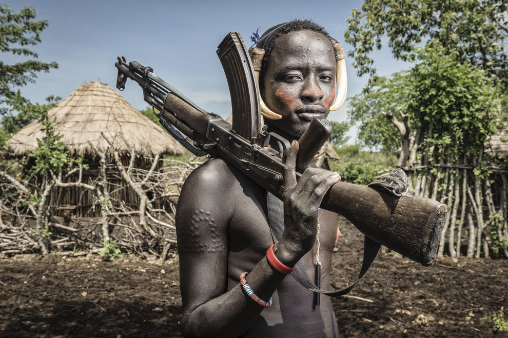 This powerful shot of a young Mursi tribe member holding an AK-47 in Ethiopia: