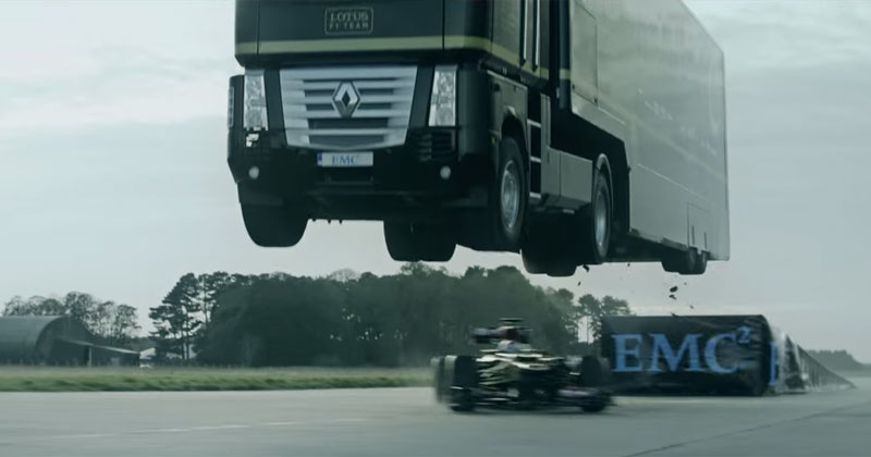 Truck Makes Record Breaking 83 ft Jump Over a Moving F1 Car