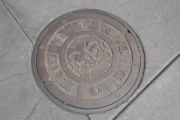 If you stand above the manhole cover in front of the Five & Dime in Toontown, you'll hear voices from underground.