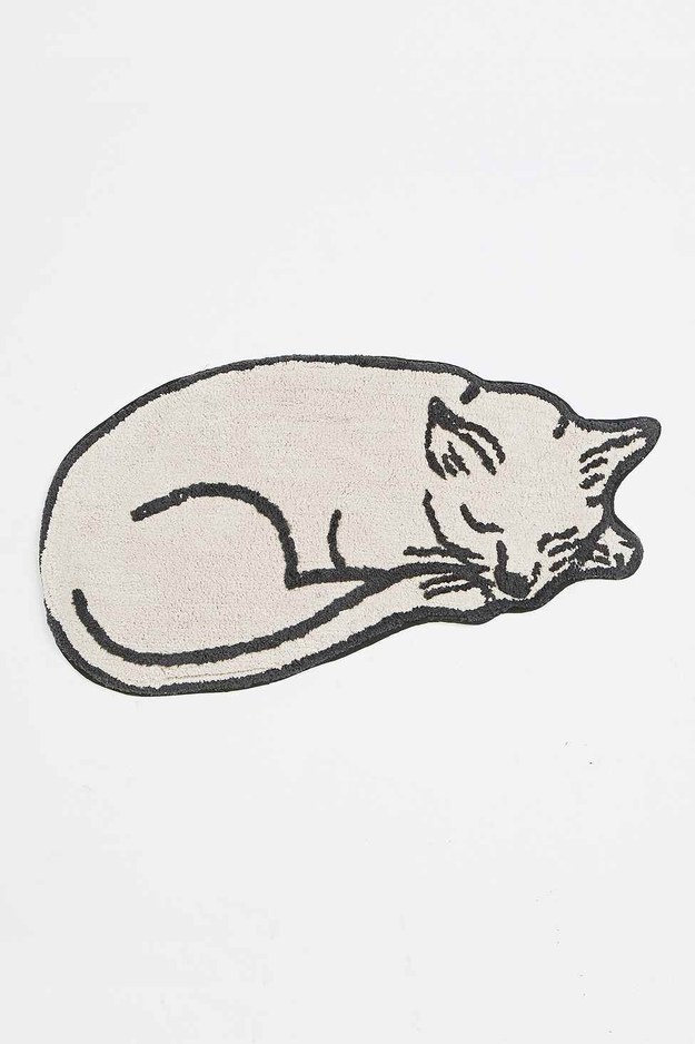 Step out in style with this sleeping cat bath matt.