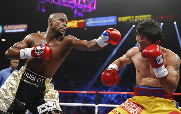 "Mayweather Defeats Pacquiao In ""Fight Of The Century"""