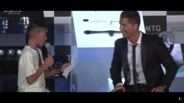 When the boy stumbles though, the audience starts laughing, only for Ronaldo to scold them.