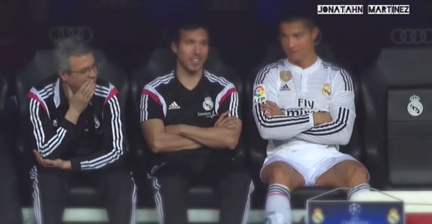 While sitting on the bench, Ronaldo noticed that some fans were screaming out near the dugout.