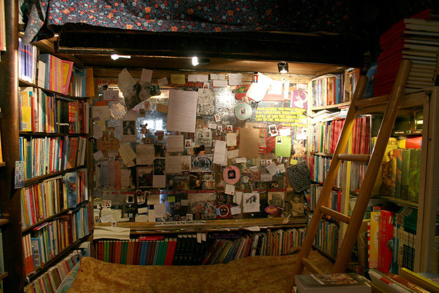 Take a visit to Shakespeare and Company bookstore in Paris to enjoy a book in this cozy space.