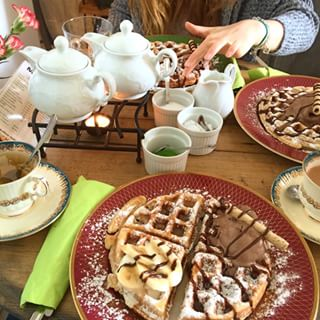 You can eat giant waffles at Yvi's House of Tea.