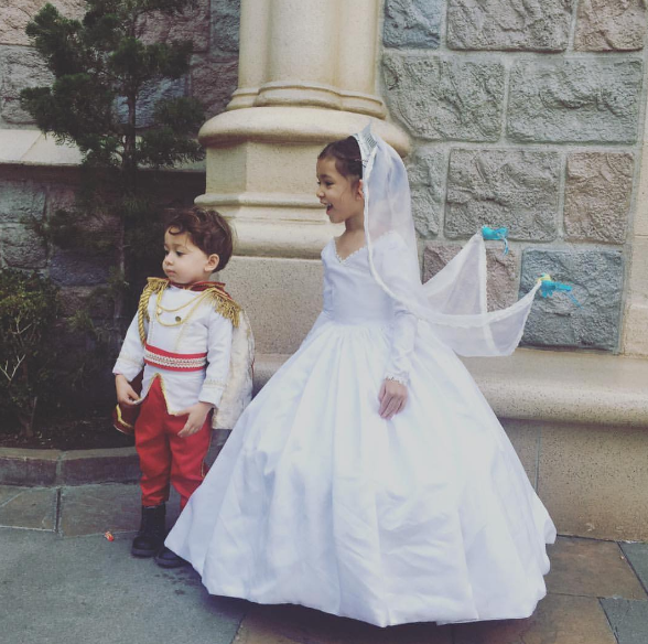 8. Garcia's daughter Lili is Cinderella the bride after she nabs her prince charming. Garcia's son is the spiffy prince. Garcia adds the beautiful touch of Cinderella's bird-friends holding up her veil.