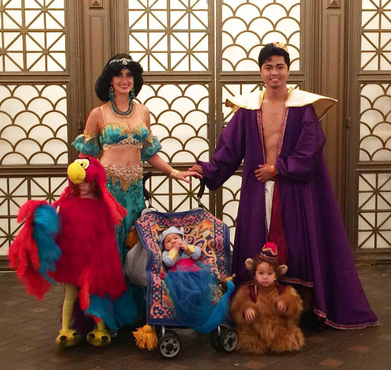 6. A costume for Aladdin, Jasmine, Abou and Iago. By this time, Aladdin and Jasmine are married and have a little baby who is also in costume! The Abou and Iago costumes are incredibly adorable.